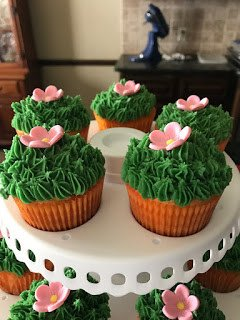 Display of Cactus Cupcakes with Flower