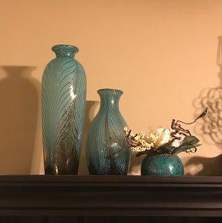 Turquoise vases with feather pattern on desk