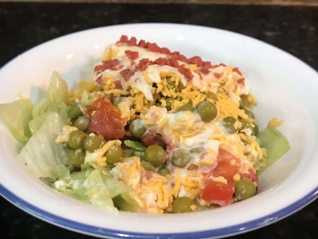 green pea salad in bowl