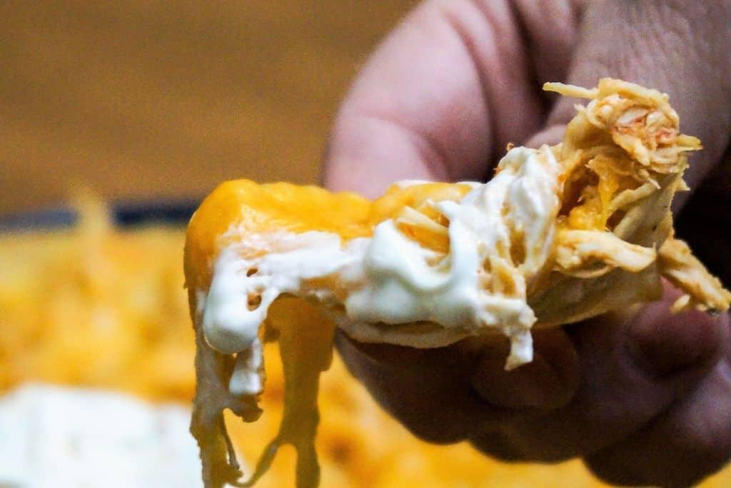 Bite of Chicken Nachos With Sour Cream