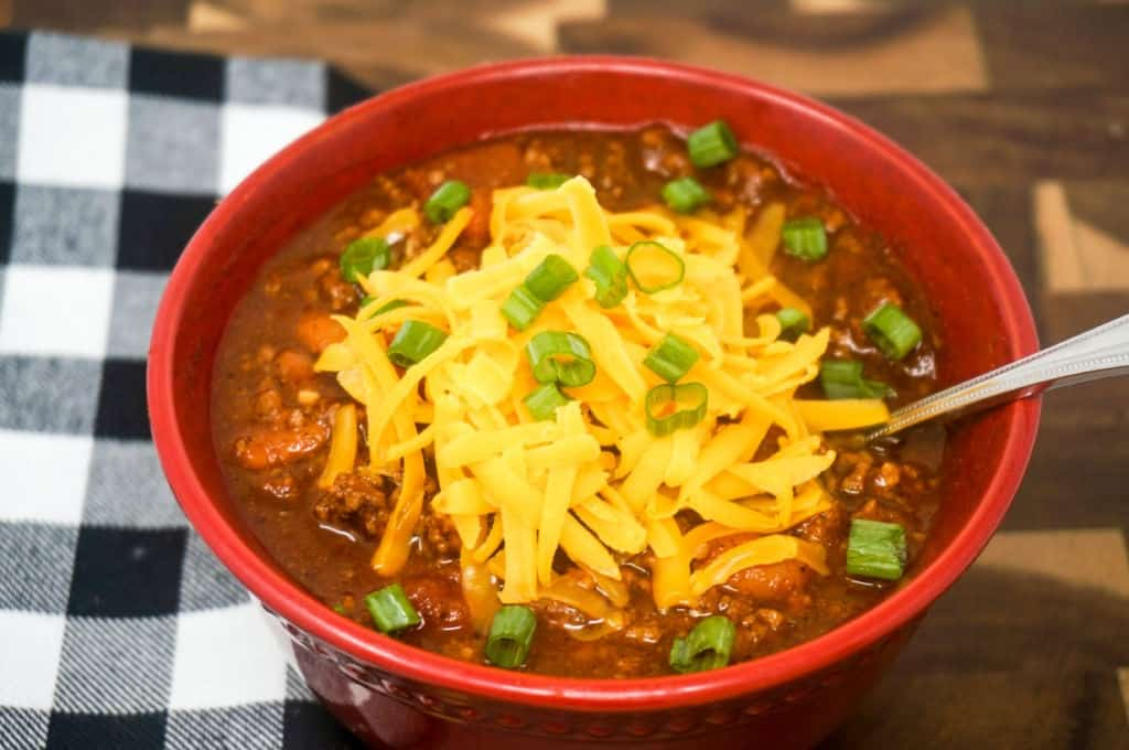 Bowl of Chili with cheese and green onions