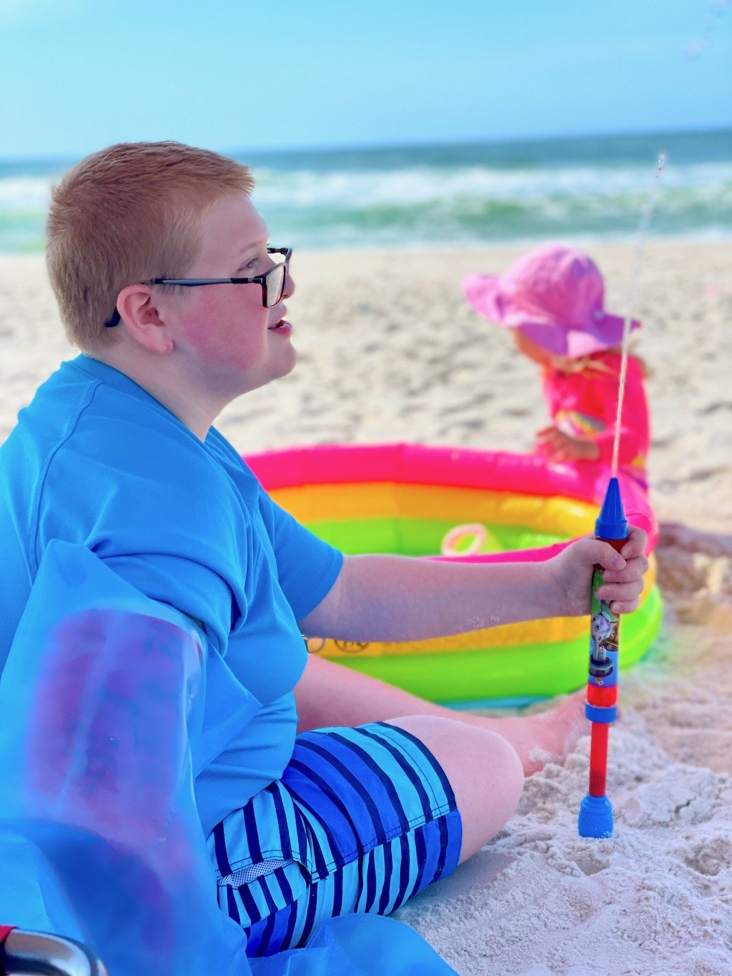 child with a full arm cast at the beach - cast cover